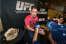 HOUSTON, TX - OCTOBER 16:  UFC Heavyweight Champion Cain Velasquez speaks with the media during the UFC 166 Ultimate Media Day at the Toyota Center on October 16, 2013 in Houston, Texas. (Photo by Jeff Bottari/Zuffa LLC/Zuffa LLC via Getty Images) *** Local Caption *** Cain Velasquez