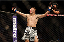 HOUSTON, TEXAS - OCTOBER 19:  (L-R) Kyoji Horiguchi celebrates after defeating Dustin Pague (not pictured) by TKO in their UFC bantamweight bout at the Toyota Center on October 19, 2013 in Houston, Texas. (Photo by Josh Hedges/Zuffa LLC/Zuffa LLC via Getty Images)