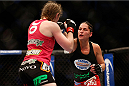 HOUSTON, TEXAS - OCTOBER 19:  (R-L) Jessica Eye punches Sarah Kaufman in their UFC women's bantamweight bout at the Toyota Center on October 19, 2013 in Houston, Texas. (Photo by Josh Hedges/Zuffa LLC/Zuffa LLC via Getty Images)