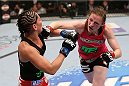 HOUSTON, TEXAS - OCTOBER 19:  (R-L) Sarah Kaufman punches Jessica Eye in their UFC women's bantamweight bout at the Toyota Center on October 19, 2013 in Houston, Texas. (Photo by Nick Laham/Zuffa LLC/Zuffa LLC via Getty Images)