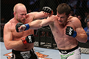 HOUSTON, TEXAS - OCTOBER 19:  (R-L) CB Dollaway punches Tim Boetsch in their UFC middleweight bout at the Toyota Center on October 19, 2013 in Houston, Texas. (Photo by Nick Laham/Zuffa LLC/Zuffa LLC via Getty Images)