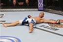 HOUSTON, TEXAS - OCTOBER 19:  John Dodson rests on the Octagon after defeating Darrell Montague (not pictured) by knockout in their UFC flyweight bout at the Toyota Center on October 19, 2013 in Houston, Texas. (Photo by Nick Laham/Zuffa LLC/Zuffa LLC via Getty Images)