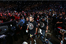 HOUSTON, TEXAS - OCTOBER 19:  Cain Velasquez enters the arena before facing Junior Dos Santos (not pictured) in their UFC heavyweight championship bout at the Toyota Center on October 19, 2013 in Houston, Texas. (Photo by Nick Laham/Zuffa LLC/Zuffa LLC via Getty Images)