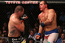 HOUSTON, TEXAS - OCTOBER 19:  (L-R) Cain Velasquez punches Junior Dos Santos in their UFC heavyweight championship bout at the Toyota Center on October 19, 2013 in Houston, Texas. (Photo by Nick Laham/Zuffa LLC/Zuffa LLC via Getty Images)