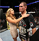 HOUSTON, TEXAS - OCTOBER 19:  Cain Velasquez celebrates with his wife Michelle while retaining the heavyweight championship belt after defeating Junior Dos Santos (not pictured) by TKO in their UFC heavyweight championship bout at the Toyota Center on October 19, 2013 in Houston, Texas. (Photo by Nick Laham/Zuffa LLC/Zuffa LLC via Getty Images)