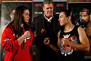 MANCHESTER, ENGLAND - OCTOBER 23:  (L-R) Opponents Rosi Sexton and Jessica Andrade face off after the UFC open workouts inside Shooterâs Sports Bar on October 23, 2013 in Manchester, England. (Photo by Josh Hedges/Zuffa LLC/Zuffa LLC via Getty Images)