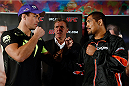 MANCHESTER, ENGLAND - OCTOBER 23:  (L-R) Opponents Lyoto Machida and Mark Munoz face off after the UFC open workouts inside Shooterâs Sports Bar on October 23, 2013 in Manchester, England. (Photo by Josh Hedges/Zuffa LLC/Zuffa LLC via Getty Images)