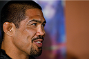 MANCHESTER, ENGLAND - OCTOBER 23:  Mark Munoz interacts with media after the UFC open workouts inside Shooterâs Sports Bar on October 23, 2013 in Manchester, England. (Photo by Josh Hedges/Zuffa LLC/Zuffa LLC via Getty Images)