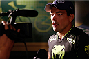 MANCHESTER, ENGLAND - OCTOBER 23:  Lyoto Machida interacts with media after the UFC open workouts inside Shooterâs Sports Bar on October 23, 2013 in Manchester, England. (Photo by Josh Hedges/Zuffa LLC/Zuffa LLC via Getty Images)