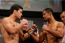 MANCHESTER, ENGLAND - OCTOBER 25:  (L-R) Opponents Lyoto Machida and Mark Munoz face off during the UFC weigh-in event at Manchester Central on October 25, 2013 in Manchester, England. (Photo by Josh Hedges/Zuffa LLC/Zuffa LLC via Getty Images)