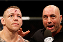 MANCHESTER, ENGLAND - OCTOBER 26:  (L-R) Ross Pearson is interviewed by Joe Rogan after his lightweight bout against Melvin Guillard during the UFC Fight Night event at Phones 4 U Arena on October 26, 2013 in Manchester, England. (Photo by Josh Hedges/Zuffa LLC/Zuffa LLC via Getty Images)