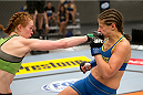 LAS VEGAS, NV - JUNE 21:  (L-R) Margaret Morgan punches Sarah Moras in their preliminary fight during filming of season eighteen of The Ultimate Fighter on June 21, 2013 in Las Vegas, Nevada. (Photo by Josh Hedges/Zuffa LLC/Zuffa LLC via Getty Images) *** Local Caption *** Sarah Moras; Margaret Morgan