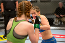 LAS VEGAS, NV - JUNE 21:  (R-L) Sarah Moras looks to strike Margaret Morgan in their preliminary fight during filming of season eighteen of The Ultimate Fighter on June 21, 2013 in Las Vegas, Nevada. (Photo by Josh Hedges/Zuffa LLC/Zuffa LLC via Getty Images) *** Local Caption *** Sarah Moras; Margaret Morgan