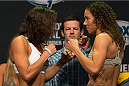 CLARKSVILLE, TN - NOVEMBER 5:  Germaine de Randamie (L) and Amanda Nunes (R) face off during the UFC Fight For the Troops weigh-in at the Fort Campbell Sabre Air Field hanger on November 5, 2013 in Clarksville, Tennessee. (Photo by Ed Mulholland/Zuffa LLC/Zuffa LLC via Getty Images)