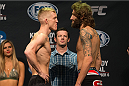 CLARKSVILLE, TN - NOVEMBER 5:  Colton Smith (L) and Michael Chiesa (R) face off during the UFC Fight For the Troops weigh-in at the Fort Campbell Sabre Air Field hanger on November 5, 2013 in Clarksville, Tennessee. (Photo by Ed Mulholland/Zuffa LLC/Zuffa LLC via Getty Images)