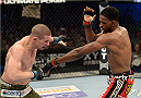 FORT CAMPBELL, KENTUCKY - NOVEMBER 6:  (R-L) Neil Magny punches Seth Baczynski in their UFC welterweight bout on November 6, 2013 in Fort Campbell, Kentucky. (Photo by Jeff Bottari/Zuffa LLC/Zuffa LLC via Getty Images) *** Local Caption ***Neil Magny; Seth Baczynski
