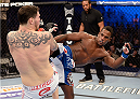 FORT CAMPBELL, KENTUCKY - NOVEMBER 6:  (R-L) Lorenz Larkin kicks Chris Camozzi in their UFC middleweight bout on November 6, 2013 in Fort Campbell, Kentucky. (Photo by Jeff Bottari/Zuffa LLC/Zuffa LLC via Getty Images) *** Local Caption ***Chris Camozzi; Lorenz Larkin