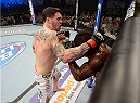 FORT CAMPBELL, KENTUCKY - NOVEMBER 6:  (L-R) Chris Camozzi punches Lorenz Larkin in their UFC middleweight bout on November 6, 2013 in Fort Campbell, Kentucky. (Photo by Jeff Bottari/Zuffa LLC/Zuffa LLC via Getty Images) *** Local Caption ***Chris Camozzi; Lorenz Larkin