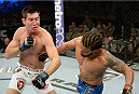 FORT CAMPBELL, KENTUCKY - NOVEMBER 6:  (L-R) Steven Siler punches Dennis Bermudez in their UFC featherweight bout on November 6, 2013 in Fort Campbell, Kentucky. (Photo by Jeff Bottari/Zuffa LLC/Zuffa LLC via Getty Images) *** Local Caption ***Dennis Bermudez; Steven Siler