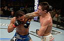 FORT CAMPBELL, KENTUCKY - NOVEMBER 6:  (L-R) Dennis Bermudez punches Steven Siler in their UFC featherweight bout on November 6, 2013 in Fort Campbell, Kentucky. (Photo by Jeff Bottari/Zuffa LLC/Zuffa LLC via Getty Images) *** Local Caption ***Dennis Bermudez; Steven Siler