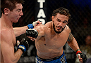 FORT CAMPBELL, KENTUCKY - NOVEMBER 6:  (R-L) Dennis Bermudez punches Steven Siler in their UFC featherweight bout on November 6, 2013 in Fort Campbell, Kentucky. (Photo by Jeff Bottari/Zuffa LLC/Zuffa LLC via Getty Images) *** Local Caption ***Dennis Bermudez; Steven Siler