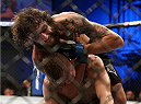 FORT CAMPBELL, KENTUCKY - NOVEMBER 6:  Michael Chiesa (top) attempts to submit Colton Smith in their UFC lightweight bout on November 6, 2013 in Fort Campbell, Kentucky. (Photo by Ed Mulholland/Zuffa LLC/Zuffa LLC via Getty Images) *** Local Caption ***Colton Smith; Michael Chiesa