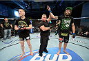 FORT CAMPBELL, KENTUCKY - NOVEMBER 6:  Michael Chiesa (right) is declared the winner over Colton Smith (left) in their UFC lightweight bout on November 6, 2013 in Fort Campbell, Kentucky. (Photo by Jeff Bottari/Zuffa LLC/Zuffa LLC via Getty Images) *** Local Caption ***Colton Smith; Michael Chiesa