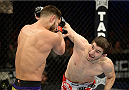 FORT CAMPBELL, KENTUCKY - NOVEMBER 6:  (R-L) Rustam Khabilov punches Jorge Masvidal in their UFC lightweight bout on November 6, 2013 in Fort Campbell, Kentucky. (Photo by Jeff Bottari/Zuffa LLC/Zuffa LLC via Getty Images) *** Local Caption ***Jorge Masvidal; Rustam Khabilov