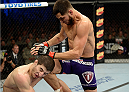 FORT CAMPBELL, KENTUCKY - NOVEMBER 6:  (R-L) Jorge Masvidal knees Rustam Khabilov in their UFC lightweight bout on November 6, 2013 in Fort Campbell, Kentucky. (Photo by Jeff Bottari/Zuffa LLC/Zuffa LLC via Getty Images) *** Local Caption ***Jorge Masvidal; Rustam Khabilov