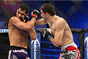 FORT CAMPBELL, KENTUCKY - NOVEMBER 6:  (R-L) Rustam Khabilov punches Jorge Masvidal in their UFC lightweight bout on November 6, 2013 in Fort Campbell, Kentucky. (Photo by Ed Mulholland/Zuffa LLC/Zuffa LLC via Getty Images) *** Local Caption ***Jorge Masvidal; Rustam Khabilov
