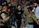FORT CAMPBELL, KENTUCKY - NOVEMBER 6:  Alexis Davis (center) walks to the Octagon to face Liz Carmouche in their UFC women's bantamweight bout on November 6, 2013 in Fort Campbell, Kentucky. (Photo by Jeff Bottari/Zuffa LLC/Zuffa LLC via Getty Images) *** Local Caption ***Alexis Davis