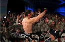 FORT CAMPBELL, KENTUCKY - NOVEMBER 6:  Tim Kennedy (bottom) greets fans after his victory over Rafael Natal in their UFC middleweight bout on November 6, 2013 in Fort Campbell, Kentucky. (Photo by Ed Mulholland/Zuffa LLC/Zuffa LLC via Getty Images) *** Local Caption ***Tim Kennedy