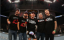 FORT CAMPBELL, KENTUCKY - NOVEMBER 6:  Tim Kennedy (center) poses with his teammates after his victory over Rafael Natal in their UFC middleweight bout on November 6, 2013 in Fort Campbell, Kentucky. (Photo by Ed Mulholland/Zuffa LLC/Zuffa LLC via Getty Images) *** Local Caption ***Tim Kennedy
