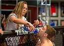 LAS VEGAS, NV - JULY 02:   Coach Ronda Rousey  hydrates Michael Wooten before his semifinal fight against Chris Holdsworth during filming of season eighteen of The Ultimate Fighter on July 2, 2013 in Las Vegas, Nevada. (Photo by Josh Hedges/Zuffa LLC/Zuffa LLC via Getty Images) *** Local Caption *** Ronda Rousey; Michael Wooten