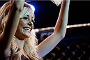 GOIANIA, BRAZIL - NOVEMBER 09: UFC Octagon Girl Jhenny Andrade introduces a round during the UFC event at Arena Goiania on November 9, 2013 in Goiania, Brazil. (Photo by Josh Hedges/Zuffa LLC/Zuffa LLC via Getty Images)