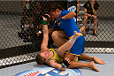 LAS VEGAS, NV - JULY 02:  (R-L) Julianna Pena punches Sarah Moras in their semifinal fight during filming of season eighteen of The Ultimate Fighter on July 2, 2013 in Las Vegas, Nevada. (Photo by Josh Hedges/Zuffa LLC/Zuffa LLC via Getty Images) *** Local Caption *** Julianna Pena; Sarah Moras