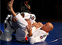 LAS VEGAS, NV - NOVEMBER 13: (R-L) UFC welterweight champion Georges St-Pierre trains with UFC legend Royce Gracie during an open workout session for media inside the Hollywood Theatre at the MGM Grand Hotel/Casino on November 13, 2013 in Las Vegas, Nevada. (Photo by Josh Hedges/Zuffa LLC/Zuffa LLC via Getty Images)