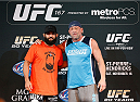 LAS VEGAS, NV - NOVEMBER 13: (L-R) Welterweight title challenger Johny Hendricks poses for a photo with UFC legend Mark Coleman before an open workout session for media inside the Hollywood Theatre at the MGM Grand Hotel/Casino on November 13, 2013 in Las Vegas, Nevada. (Photo by Josh Hedges/Zuffa LLC/Zuffa LLC via Getty Images)