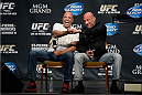 LAS VEGAS, NEVADA - NOVEMBER 15:  UFC legends Royce Gracie (L) and Mark Coleman interact with fans during a Q&A session before the UFC 167 weigh-in event at the MGM Grand Garden Arena on November 15, 2013 in Las Vegas, Nevada. (Photo by Jeff Bottari/Zuffa LLC/Zuffa LLC via Getty Images)
