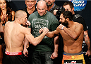 LAS VEGAS, NV - NOVEMBER 15:  (L-R) Opponents Georges St-Pierre and Johny Hendricks face off during the UFC 167 weigh-in inside the MGM Grand Garden Arena on November 15, 2013 in Las Vegas, Nevada. (Photo by Josh Hedges/Zuffa LLC/Zuffa LLC via Getty Images)