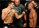 LAS VEGAS, NV - NOVEMBER 15:  (L-R) Opponents Rory MacDonald and Robbie Lawler face off during the UFC 167 weigh-in inside the MGM Grand Garden Arena on November 15, 2013 in Las Vegas, Nevada. (Photo by Josh Hedges/Zuffa LLC/Zuffa LLC via Getty Images)