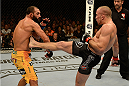 LAS VEGAS, NV - NOVEMBER 16:  (R-L) Georges St-Pierre kicks Johny Hendricks in their UFC welterweight championship bout during the UFC 167 event inside the MGM Grand Garden Arena on November 16, 2013 in Las Vegas, Nevada. (Photo by Donald Miralle/Zuffa LLC/Zuffa LLC via Getty Images) *** Local Caption *** Georges St-Pierre; Johny Hendricks