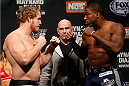 LAS VEGAS, NV - NOVEMBER 29:  (L-R) Opponents Jared Rosholt and Walt Harris face off during the weigh-in for The Ultimate Fighter season 18 live finale inside the Mandalay Bay Events Center on November 29, 2013 in Las Vegas, Nevada. (Photo by Josh Hedges/Zuffa LLC/Zuffa LLC via Getty Images)
