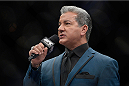LAS VEGAS, NV - NOVEMBER 30:  UFC Octagon announcer Bruce Buffer introduces Raquel Pennington and Roxanne Modafferi before their women's bantamweight fight during The Ultimate Fighter season 18 live finale inside the Mandalay Bay Events Center on November 30, 2013 in Las Vegas, Nevada. (Photo by Jeff Bottari/Zuffa LLC/Zuffa LLC via Getty Images) *** Local Caption *** Bruce Buffer