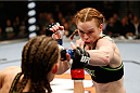 LAS VEGAS, NV - NOVEMBER 30:  (R-L) Peggy Morgan punches Jessamyn Duke in their women's bantamweight fight during The Ultimate Fighter season 18 live finale inside the Mandalay Bay Events Center on November 30, 2013 in Las Vegas, Nevada. (Photo by Josh Hedges/Zuffa LLC/Zuffa LLC via Getty Images) *** Local Caption *** Jessamyn Duke; Peggy Morgan