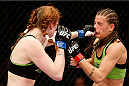 LAS VEGAS, NV - NOVEMBER 30:  (L-R) Peggy Morgan punches Jessamyn Duke in their women's bantamweight fight during The Ultimate Fighter season 18 live finale inside the Mandalay Bay Events Center on November 30, 2013 in Las Vegas, Nevada. (Photo by Josh Hedges/Zuffa LLC/Zuffa LLC via Getty Images) *** Local Caption *** Jessamyn Duke; Peggy Morgan
