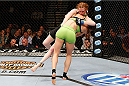LAS VEGAS, NV - NOVEMBER 30:  Jessamyn Duke (green shorts) takes down Peggy Morgan in their women's bantamweight fight during The Ultimate Fighter season 18 live finale inside the Mandalay Bay Events Center on November 30, 2013 in Las Vegas, Nevada. (Photo by Josh Hedges/Zuffa LLC/Zuffa LLC via Getty Images) *** Local Caption *** Jessamyn Duke; Peggy Morgan