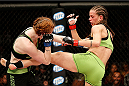 LAS VEGAS, NV - NOVEMBER 30:  (R-L) Jessamyn Duke kicks Peggy Morgan in their women's bantamweight fight during The Ultimate Fighter season 18 live finale inside the Mandalay Bay Events Center on November 30, 2013 in Las Vegas, Nevada. (Photo by Josh Hedges/Zuffa LLC/Zuffa LLC via Getty Images) *** Local Caption *** Jessamyn Duke; Peggy Morgan