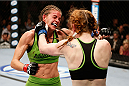 LAS VEGAS, NV - NOVEMBER 30:  (L-R) Jessamyn Duke exchanges punches with Peggy Morgan in their women's bantamweight fight during The Ultimate Fighter season 18 live finale inside the Mandalay Bay Events Center on November 30, 2013 in Las Vegas, Nevada. (Photo by Josh Hedges/Zuffa LLC/Zuffa LLC via Getty Images) *** Local Caption *** Jessamyn Duke; Peggy Morgan