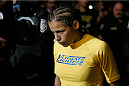 LAS VEGAS, NV - NOVEMBER 30:  Julianna Pena enters the arena before facing Jessica Rakoczy in their women's bantamweight final fight during The Ultimate Fighter season 18 live finale inside the Mandalay Bay Events Center on November 30, 2013 in Las Vegas, Nevada. (Photo by Josh Hedges/Zuffa LLC/Zuffa LLC via Getty Images) *** Local Caption *** Julianna Pena; Jessica Rakoczy